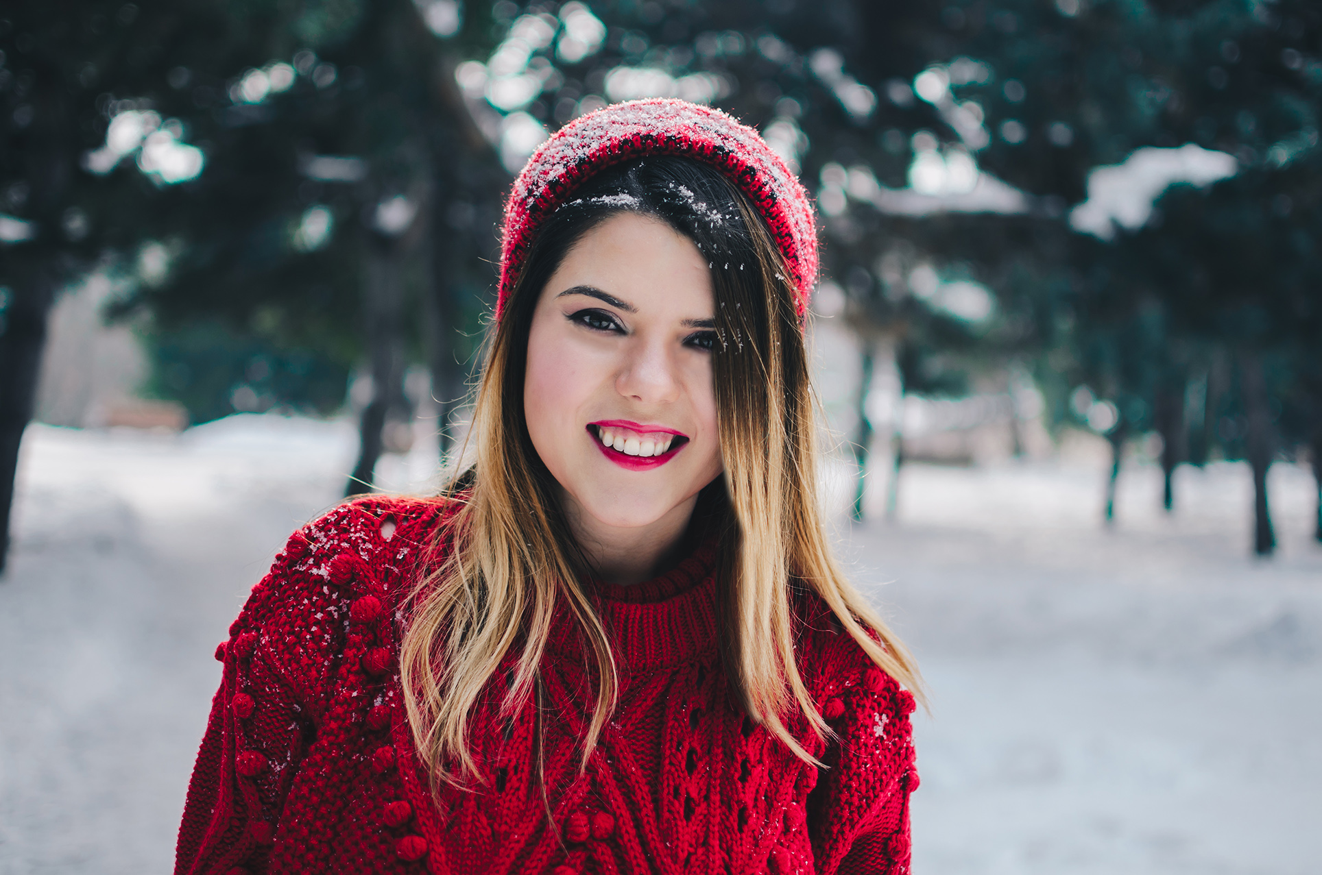 red beanie and sweater
