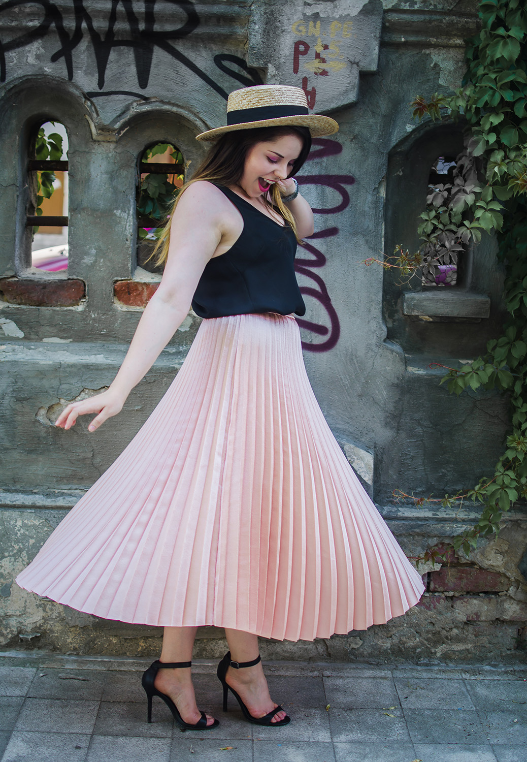 pink pleated skirt twirl