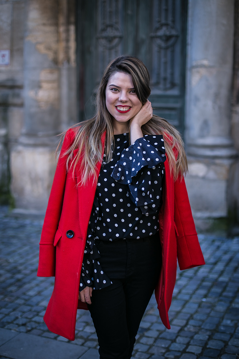 red coat and black outfit
